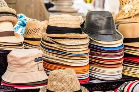 Collection of summer hats on the street market. Close-up.