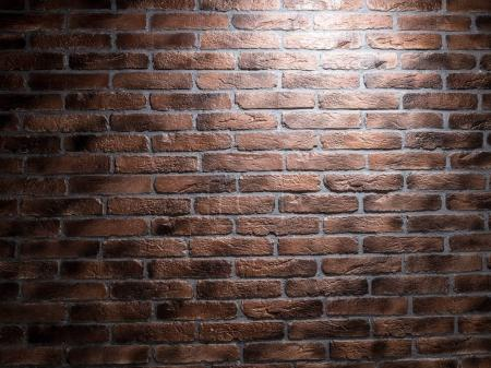 Dark brown brick wall.