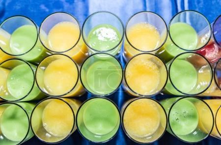 Colorful glasses of fruit juice. Top view.