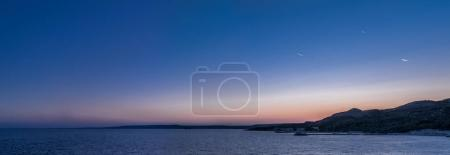 Calm sea and cloudless evening sky. Nature background.
