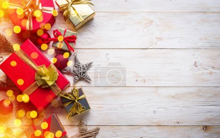 Photo for Christmas decor and gift boxes on the wooden table. Christmas or New Year holiday background. Top view. - Royalty Free Image