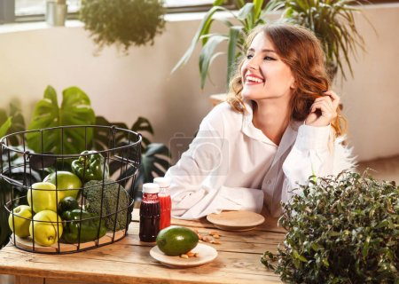 Girl At Table with Healthy Food