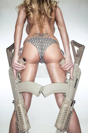 Blonde woman with guns