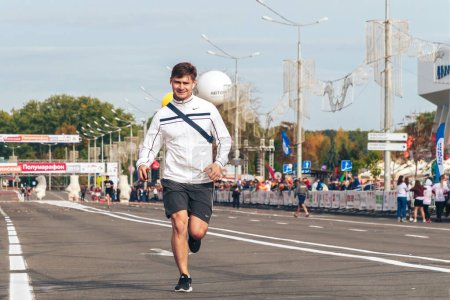 Photo for September 15, 2018 Minsk Belarus Half Marathon Minsk 2019 Athlete without a number runs a marathon along the city road - Royalty Free Image