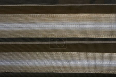 Photo for Abstraction, reflection of light stripes on a brown background.Light and darkness.Planet in the universe - Royalty Free Image