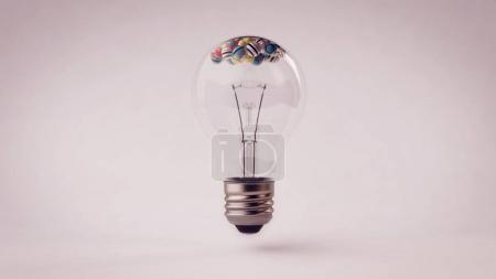 Transparent Light Bulb with Balls in it.