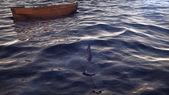 Empty Boat in Ocean Waves
