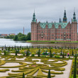 Постер, плакат: Frederiksborg Castle in Hillerod in rainy weather Denmark