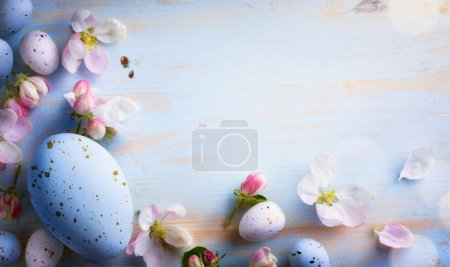 Photo for Easter background with Easter eggs and spring flowers. Top view with copy space - Royalty Free Image