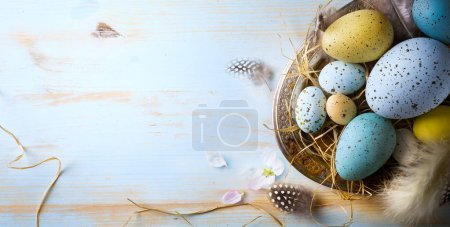 Easter background with Easter eggs and spring flowers. Top view