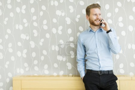Man with mobile phone in the office