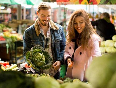 Loving couple at vegetable market