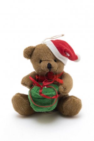 Cute toy bear with Christmas gift
