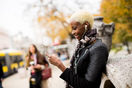 Modern african american woman with phone