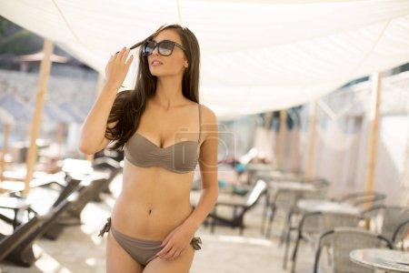 Woman on the beach in a bikini