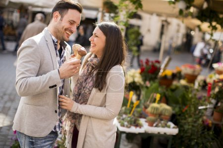 Loving couple eating ice cream