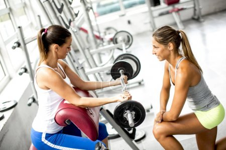 Young women exercising in a gym