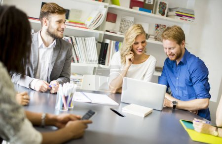 Group of young colleagues sitting on modern office