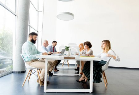 Photo for View at business people around table during staff meeting in the office - Royalty Free Image