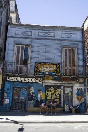 BUENOS AIRES, ARGENTINA - JANUARY 20, 2018: Unindentified people  Caminito street in La Boca, Buenos Aires, Argentina. This 100m long traditional alley full of colorful houses was one of biggest tourist hotspot in Buenos Aires.
