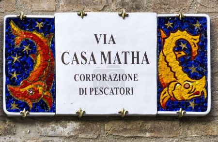Decorative street sign on the building from Ravenna, Italy