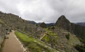 MACHU PICCHU, PERU, JANUARY 3, 2018: Unidentified people at remains of ancient Inca citadel in Machu Picchu, Peru. Almost 2500 tourists visit Machu Picchu every day.