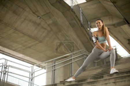 Photo for Young woman exercise in urban enviroment - Royalty Free Image