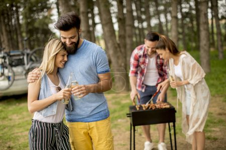 Photo for Group of young people enjoying barbecue party in the nature - Royalty Free Image