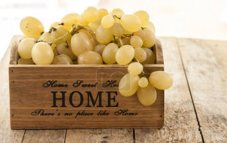 fresh grapes on wooden background