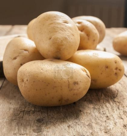 Raw potato food . Fresh potatoes