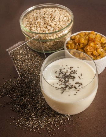 Oats in wooden bowl and muesli ingredients