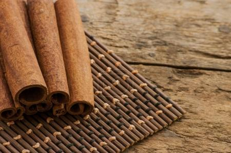 cinnamon on wooden background and coffee