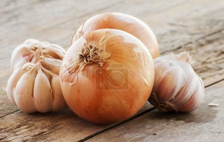 garlic and onion on cutting board