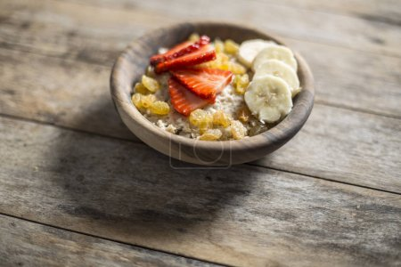 Oatmeal porridge with strawberry and banana