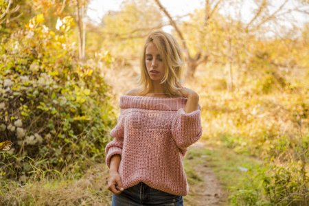 Photo for Autumn portrait of woman outside with pink sweader - Royalty Free Image