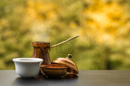 Hot tasty steaming coffee brewed in traditional tu...