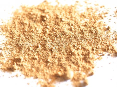 Ginger (Zingiber officinale) powder over white