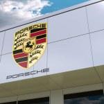 Постер, плакат: Porsche logo on the modern building facade Editorial 3D rendering