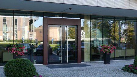 Modern office or residential building doorway reflecting street