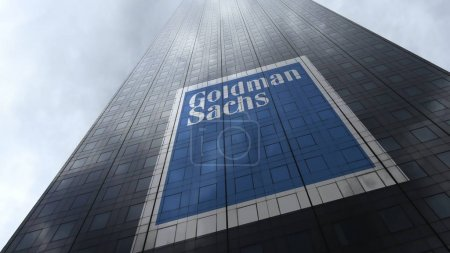 The Goldman Sachs Group logo on a skyscraper facade reflecting clouds. Editorial 3D rendering