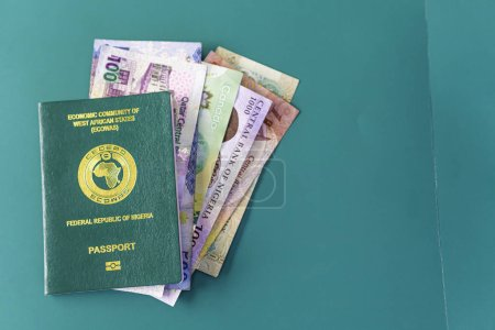 Nigerian Passport with various currencies - Naira,...