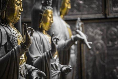 Row of Buddha statues at Ganagarama temple, Colombo, Sri Lanka.