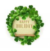 Happy Holiday text in frame of shamrocks