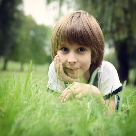 Cute boy in grass