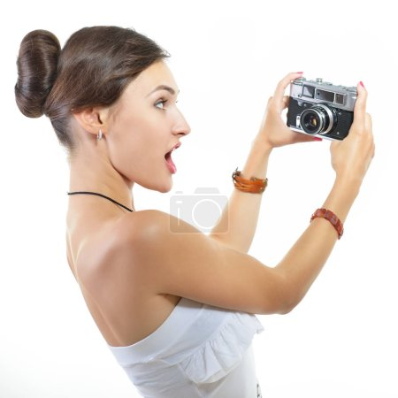 Photographer holding retro camera