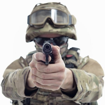 Photo for Military man in camouflage uniform, armor vest, dark glasses and helmet with gun aiming at the enemy - Royalty Free Image