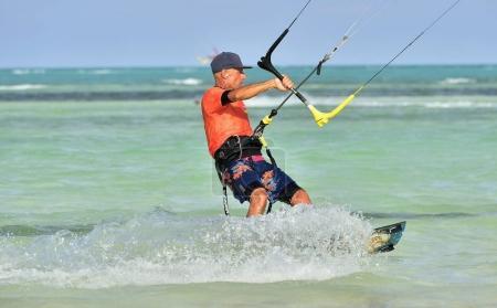 Cayo Guillermo, Cuba - December 17 2017: Man riding his kiteboard on Cayo Guillermo in Atlantic Ocean, Enjoy kite surfing. December 2017 in Cuba. Caya Guillermo is a popular beach for kitesurfing.