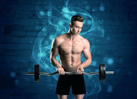 Attractive strong fitness guy lifting weight