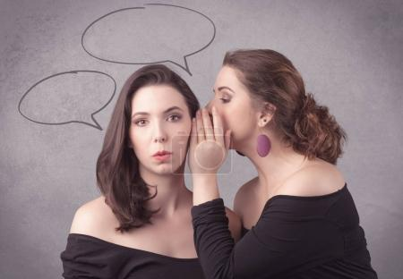 girl telling secret things to her girlfriend