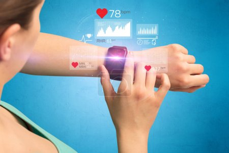 Photo pour Female hand with smartwatch and health application icons nearby. - image libre de droit